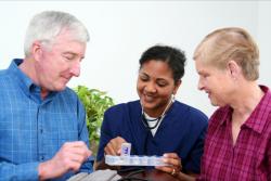 nurse giving medicines to patient